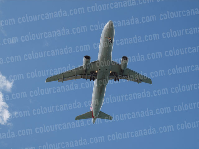 Airplane Landing Approaching Runway | Cheap Stock Photo