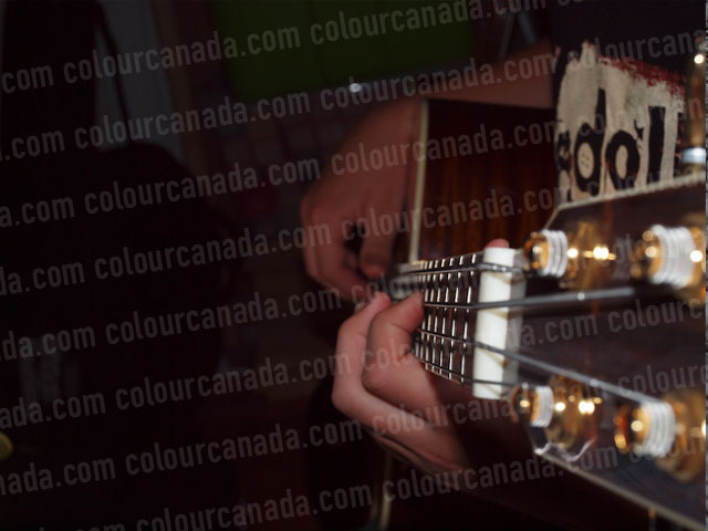 Bass Player with Close Up of Fret Board | Cheap Stock Photo