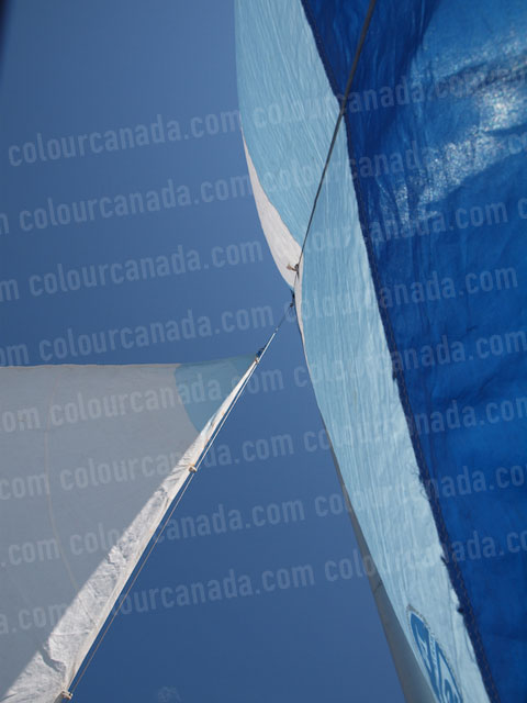 Sails Set Against a Blue Sky | Cheap Stock Photo