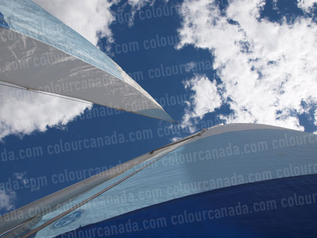 Blue and White Sails Against Sky | Cheap Stock Photo