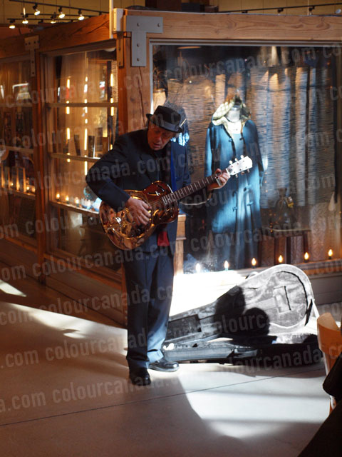 Busker Playing the Guitar | Cheap Stock Photo