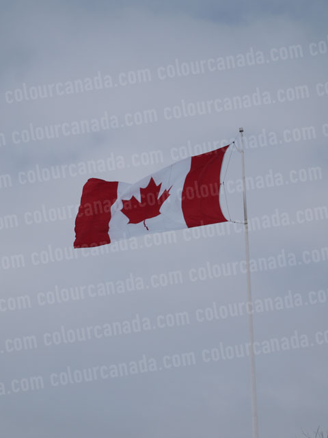 Canadian Flag Against Grey Sky (4) | Cheap Stock Photo