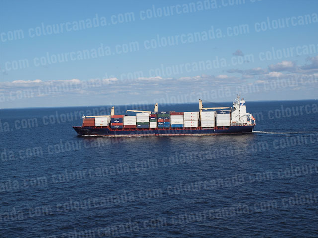 Fully Loaded Cargo Ship at Sea | Cheap Stock Photo