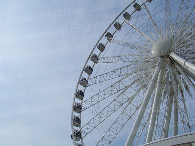 Ferris Wheel Against Blue Sky | Cheap Stock Photo