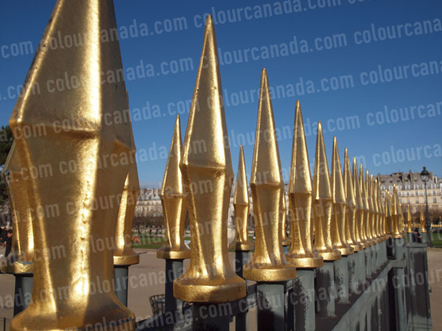Gold Fence Spikes | Cheap Stock Photo