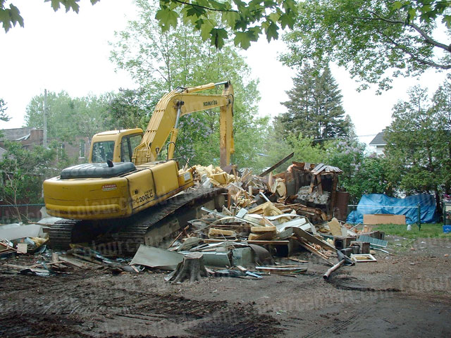 House Being Demolished by an Excavator | Cheap Stock Photo