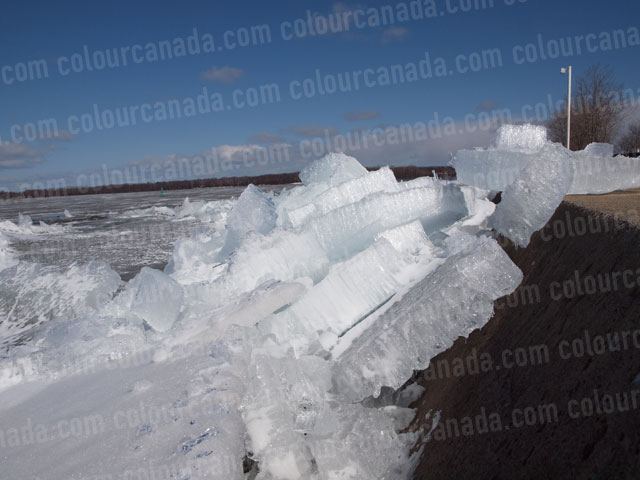 Ice Piled Against a Pier in Spring | Cheap Stock Photo