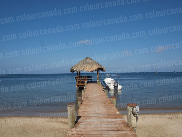 Caribbean Dock with Palapa and Boat | Cheap Stock Photo