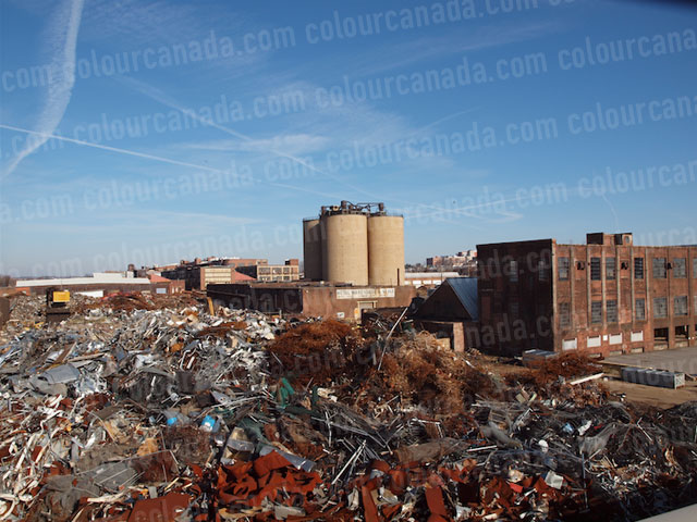 Scrap Yard Brick Building & Rusted Metal | Cheap Stock Photo