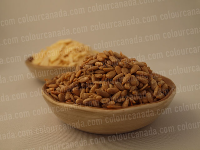 Seeds and Almonds in Bowls | Cheap Stock Photo