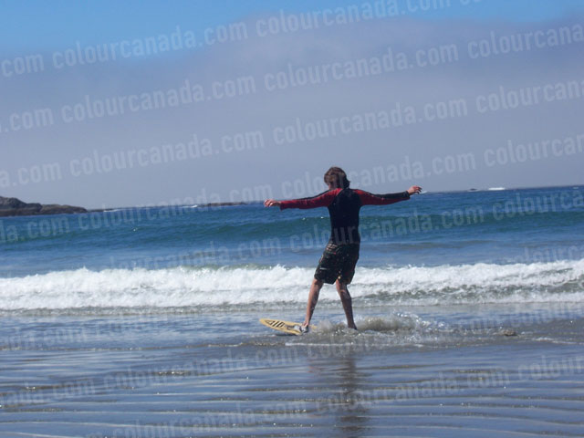 Teenager Skim Boarding | Cheap Stock Photo