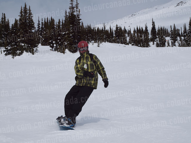 Snowboarder with Area for Text in the Snow | Cheap Stock Photo