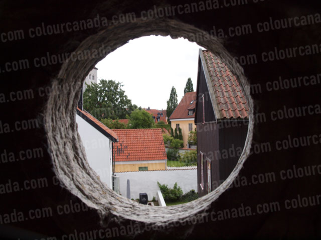 Visby, Sweden Through a Round Stone Window | Cheap Stock Photo