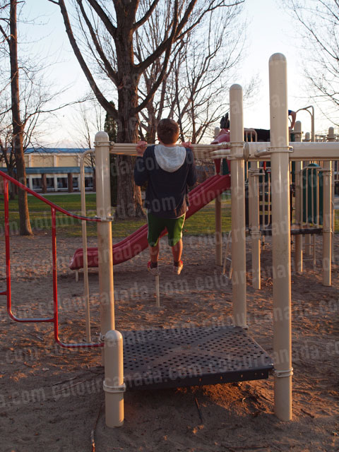 Teenager Chin Up on Play Structure | High Res Cheap Stock Photo